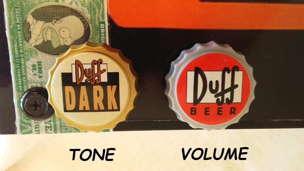 Duff beer guitar by Jim S. volume and tone knobs