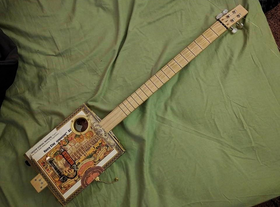 Terry C.'s 3-string guitar gift built with moped parts