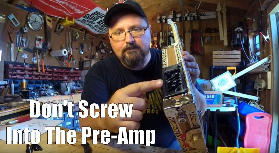 Shane Speal warns to beware of a long box handle screw piercing a cigar box guitar pre-amp