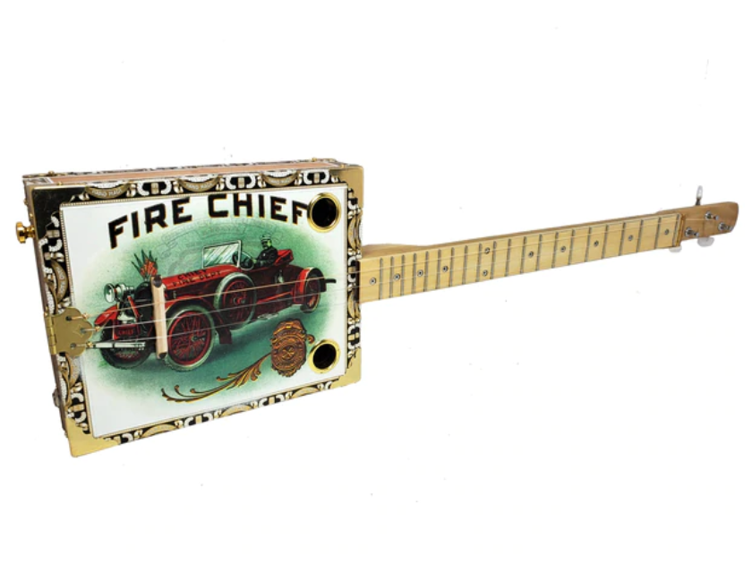 "One of a Kind ""Fire Chief"" Vintage Art Illustrated 3-string Cigar Box Guitarcbgitty.com/cigar-box-guitars-more/one-of-a-kind-fire-chief-vintage-art-illustrated-3-string-cigar-box-guitar/"