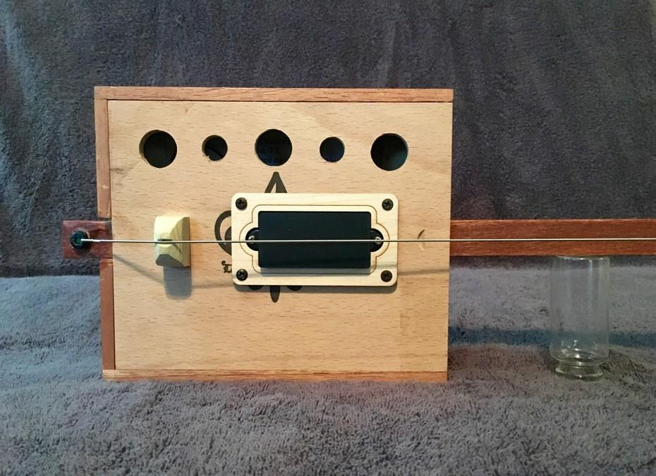 Poorness Studios' Bukey Bow: the one-string, electrified, tenor uke-scale, cigar box bass