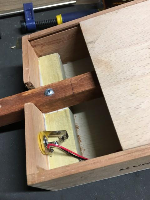 Leads soldered to jack in sliding-lid cigar box