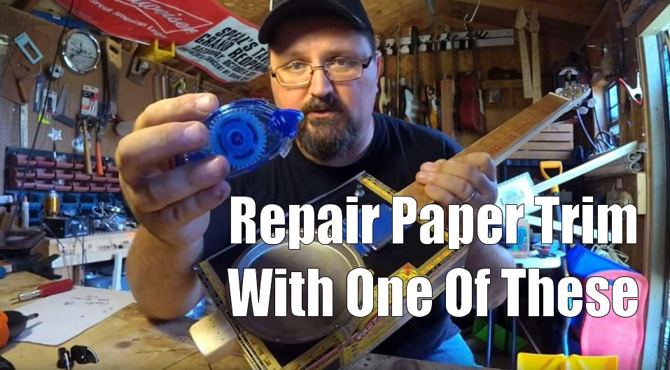 Shane Speal uses a glue roller to repair trim on paper-covered cigar boxes