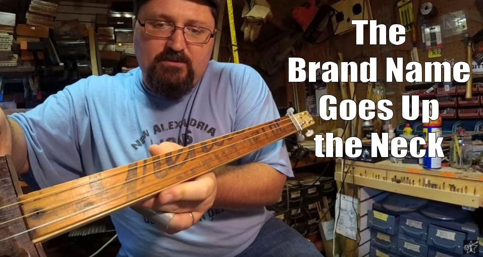 Shane Speal displays a fruit crate fretboard with the brand name displayed