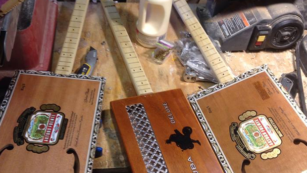 A few different cigar box guitars on Shane Speal's workbench